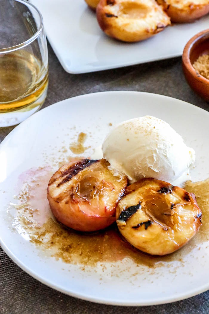 Grilled peaches recipe with brown sugar bourbon sauce? Nothing says Southern American summer than a Georgia grilled peaches recipe with Kentucky bourbon.